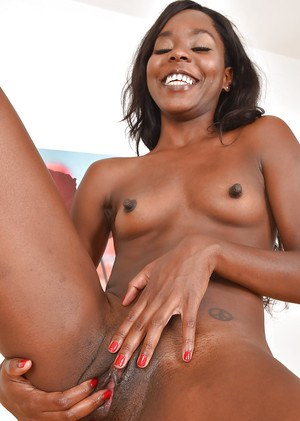 Black babe with small tits and puffy nipples masturbating shaved vagina