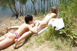 Young teen dykes Nicoletta H and Nessy undress each other outdoors