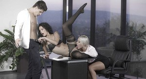 European office workers Leanna Sweet and Victoria Summers giving 3some bj
