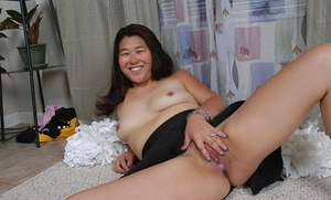 Asian amateur strips off cheerleader uniform before spreading pussy lips