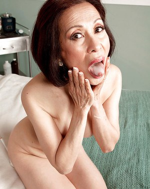Over 60 Asian MILF Kim Anh and massive cock engaging in hardcore sex