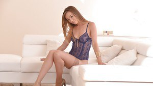Stocking and heel clad babe Capri Anderson freeing nice ass from lingerie