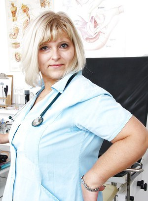 Older obese nurse freeing hairy cooter from uniform for toying session