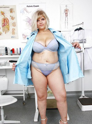 Mature BBW nurse Sisi letting large saggy breasts fall free from uniform