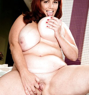 Obese redhead Roxee Robinson unleashing large tits from lingerie