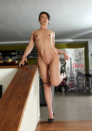 Mature brunette Zoe Gyro revealing small tits and long legs in high heels
