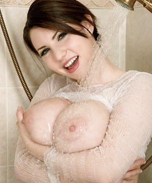 Euro babe Karina Hart exposing huge MILF juggs and shaved pussy in shower