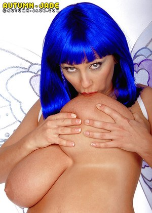 Blue haired MILF pornstar Autumn Jade flaunting huge tits in cosplay outfit