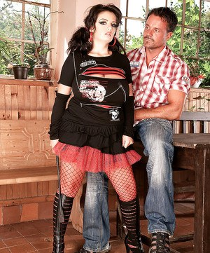 Buxom fishnet and boot garbed MILF Arianna Sinn engaging in hardcore sex