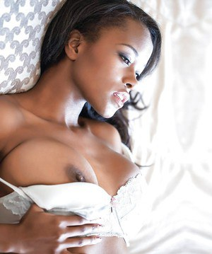 Ebony dime Izabel Vessir baring big black pornstar tits and spread pussy