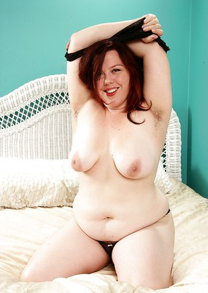 Mature BBW freeing large boobs and hairy vagina from lingerie and panties