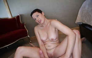 Short haired older mom with shaved vagina jacking cock Gonzo style
