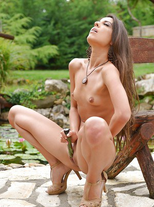 Thin brunette babe toying and masturbating outdoors in high heels