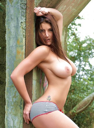 Brunette Euro babe Emma Twigg freeing large natural tits and ass outdoors