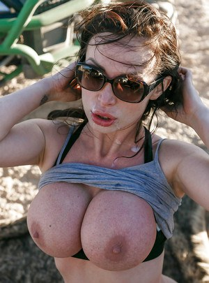 Chesty European MILF pornstar Nikki Benz having phat ass exposed outdoors