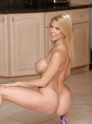 Mature blonde wife Alexis Fawx revealing large juggs while undressing