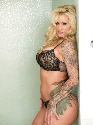 Tattooed aged blond Ryan Conner showing off fat ass and big boobs in shower
