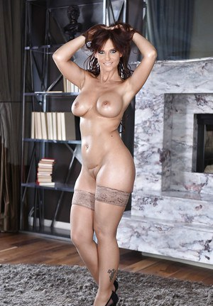 Stocking attired MILF pornstar Syren De Mer loosing big boobs from lingerie