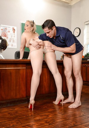 Blonde MILF teacher Alexis Texas rolling nylons over big ass and down legs