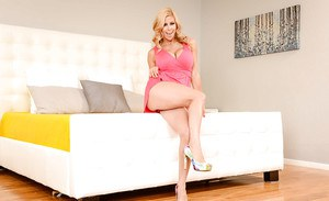 Aged blonde Alexis Fawx loosing large tits from lingerie in high heels