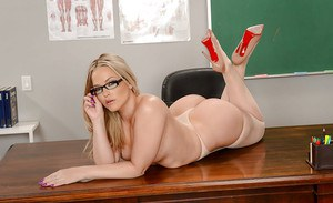 Blonde teacher Alexis Texas freeing big butt from pantyhose for babe shoot