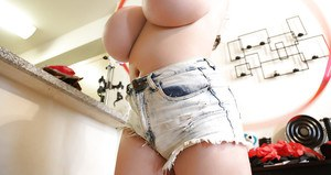 Tattooed babe Leanne Crow flaunting massive melons in denim shorts