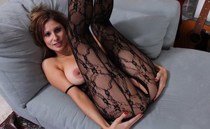 Mature lady Carla 3 freeing large natural tits from crotchless bodystocking