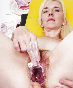 Mature lady undergoing hairy pussy examination at gyno office