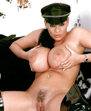 Solo girl Linsey Dawn McKenzie flaunting huge MILF tits in fetish garb
