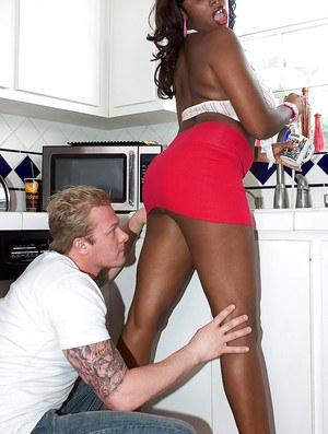 Ebony MILF Candace Von freeing big black ass from panties in kitchen