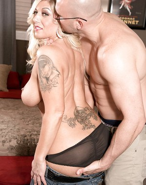 Tattooed mature lady Ginger Black taking hardcore pounding of shaved cunt