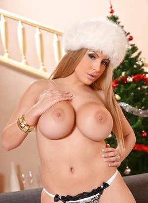 Blonde babe Anastasia Sweet freeing big tits and ass from lingerie at X-mas