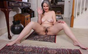Mature plumper Lexy Lou rolling off pantyhose for spreading of hairy pussy