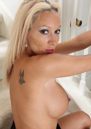 Mature blonde unveiling large tits before sliding pantyhose over sexy legs