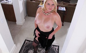 Stocking clad mature lady Lynn Miller baring big tits and spread pussy