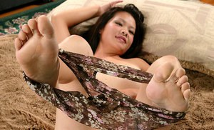 Amateur Asian babe freeing big natural tits and trimmed twat from lingerie