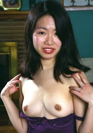 Amateur Asian babe with tiny tits spreading hairy vagina in stockings