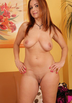 Mature Euro lady Jessica Red exposing big natural tits in high heels