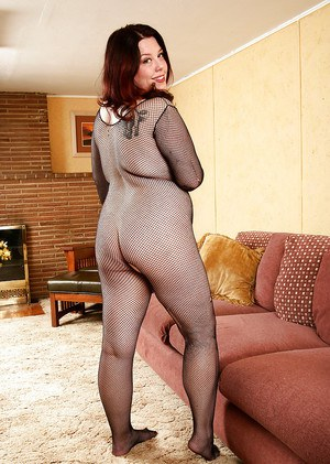 Older fatty in crotchless bodystocking exposing hairy vagina