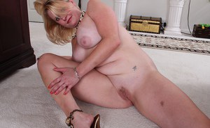 Clothed mature blonde woman Lynn Miller revealing big boobs and ass