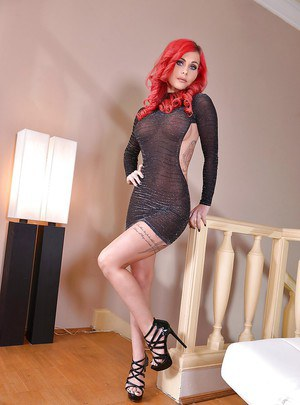 Tattooed European redhead Roxi Keogh showing off great legs and barefeet