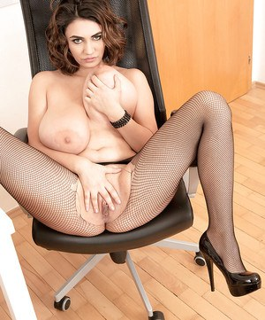 Mesh pantyhose adorned babe unveiling huge boobs and shaved cunt in office