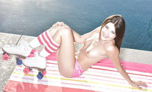 Teen babe Adria Rae baring small tits outdoors in knee high sports socks