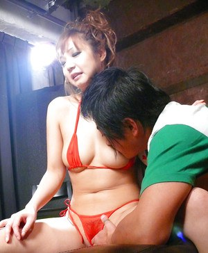Jap chick Mizuki Ishikawa freeing big tits from bikini before beaver toying