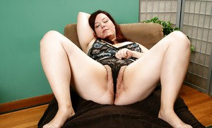 Aged BBW sliding panties to one side for hairy mature pussy exposure