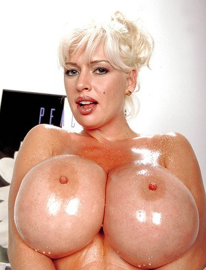 Thick mature pornstar SaRenna Lee revealing massive tits while working out