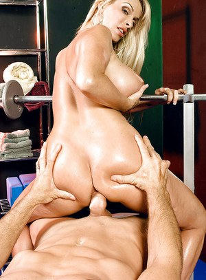 Blonde MILF Holly Halston displaying nice melons while working out