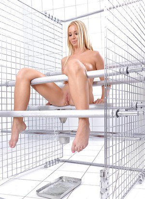 Busty blonde babe Kiara Lord locked in cage and until pissing herself