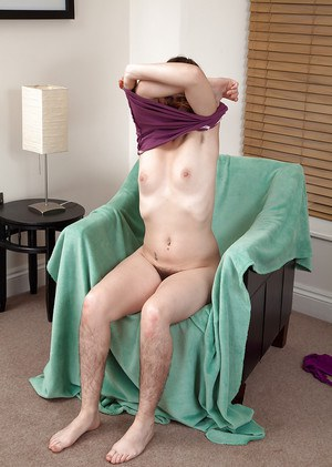 Pierced hirsute woman removing shorts to expose hairy mature pussy