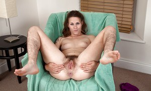 Mature solo girl flaunting hairy legs and underarms before spreading beaver